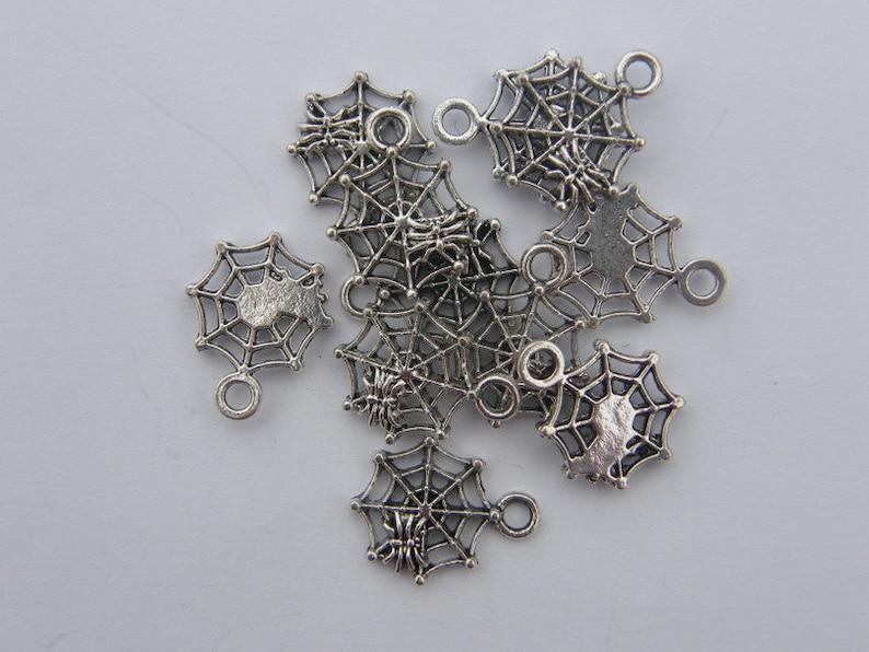BULK 50 Spider in a spiderweb charms tibetan silver HC124