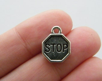 4 Stop sign charms antique silver tone P256