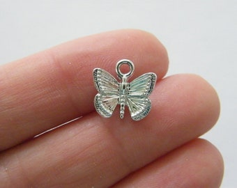 10 Butterfly charms silver tone A398
