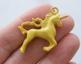 4 Unicorn charms mustard yellow tone A665