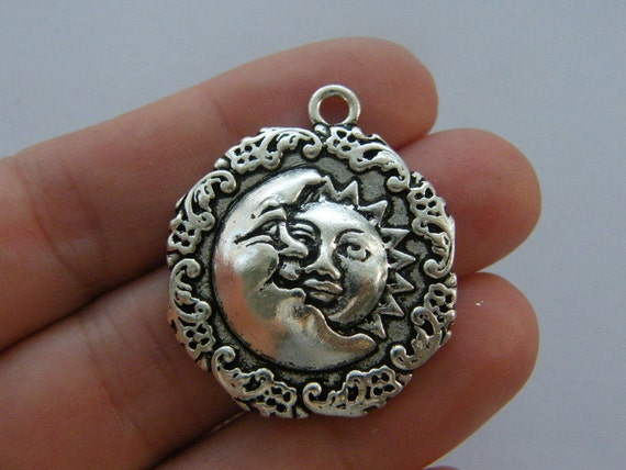 10 Sun charms antique silver tone S61