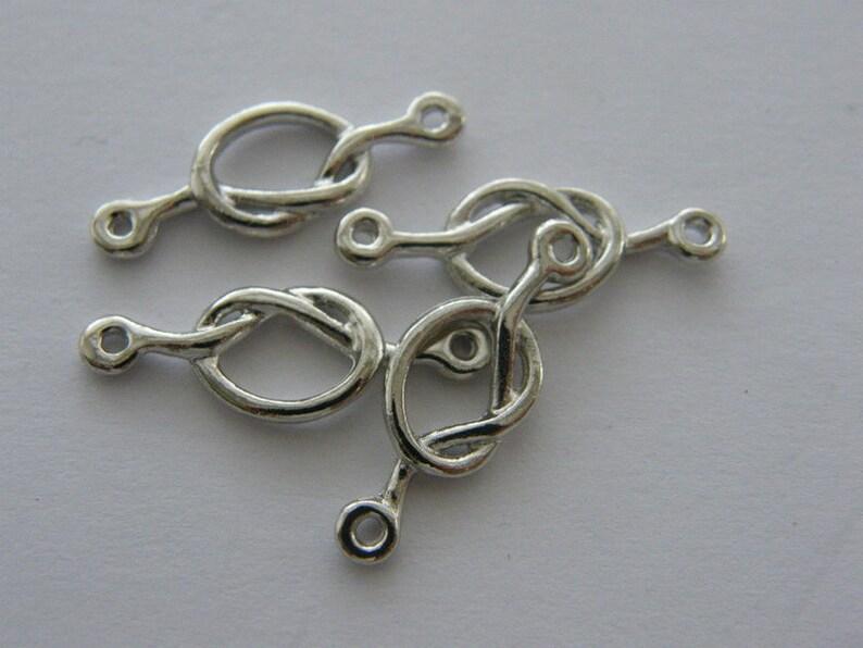 BULK 30 love knot connector charm antique silver tone R111