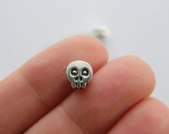 14 Skull spacer beads charms antique silver tone HC46