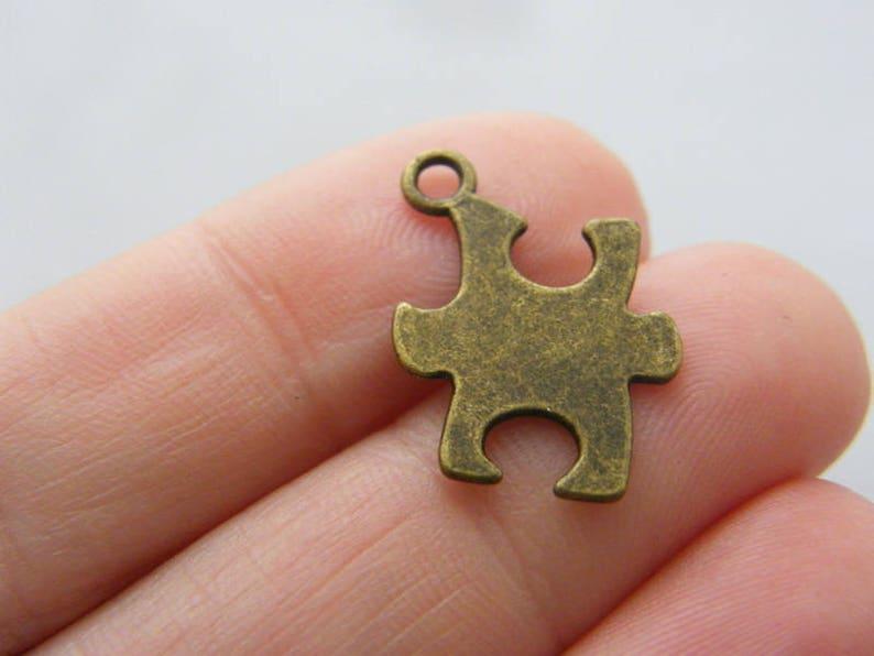 BULK 50 Puzzle piece pendants antique bronze tone BC195 SALE 50/% OFF