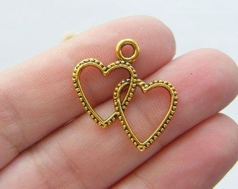 8 Heart charms antique gold tone GC375