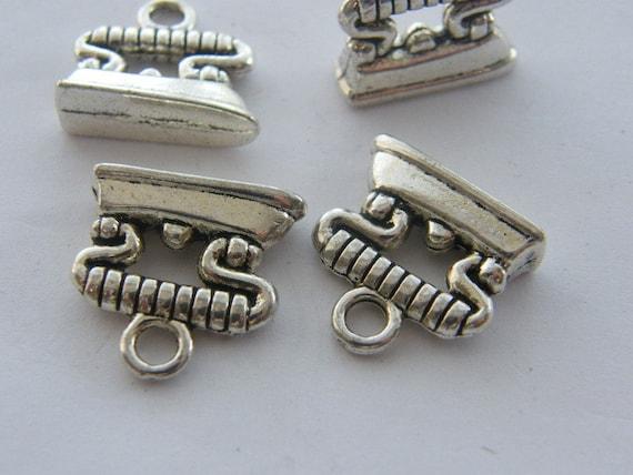 4 Iron charms antique silver tone P401