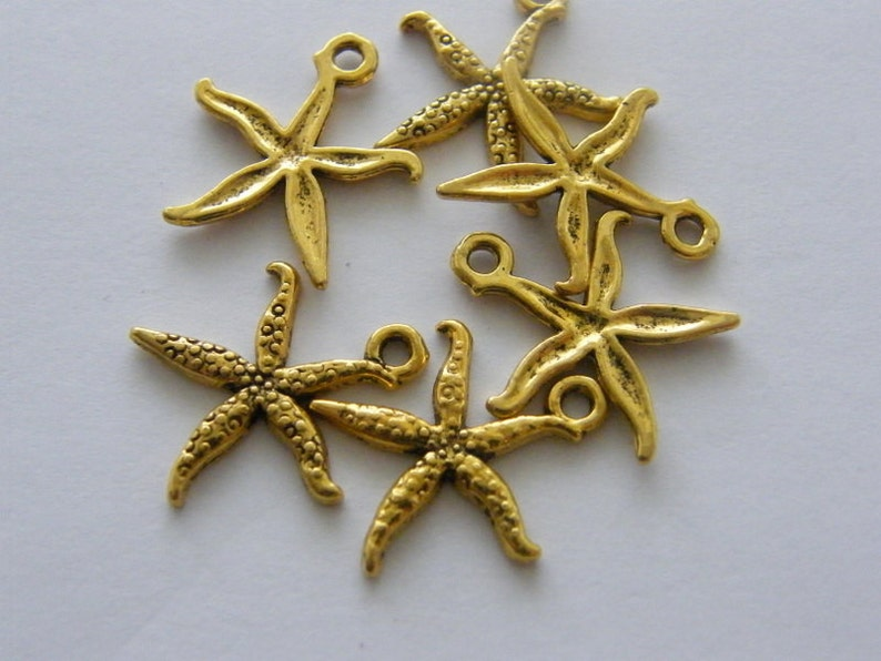 BULK 50 Starfish charms antique gold tone GC48