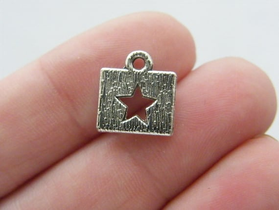 14 Star charms antique silver tone S45