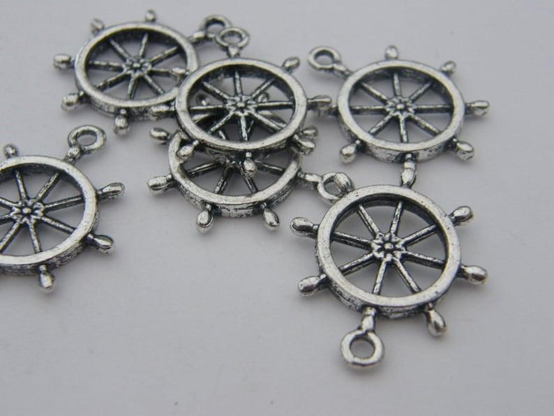BULK 50 Helm charms antique silver tone SC3