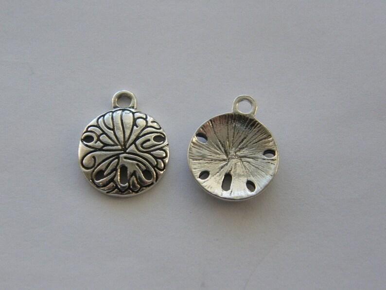 4 Sand dollar charms antique silver tone FF355