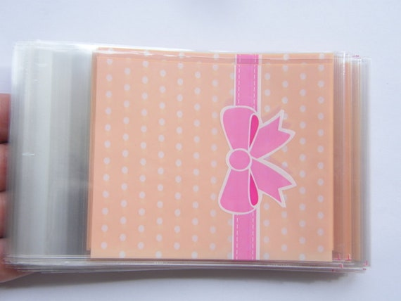 100 Pinky peach dots and pink bow cellophane packet bags - self sealing and resealable