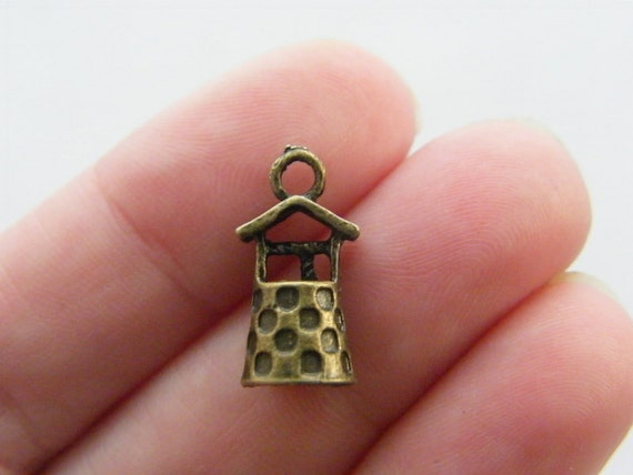 12 Well charms antique bronze tone BC132