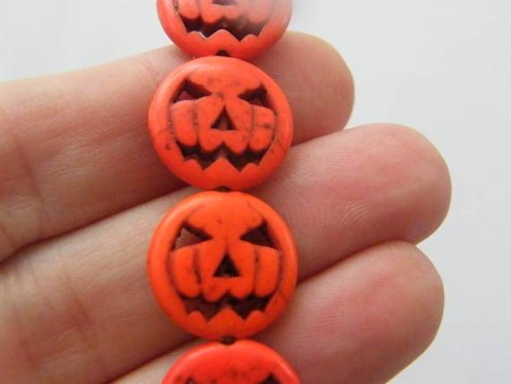 26 Purple pumpkin jack o lantern Halloween beads SK9