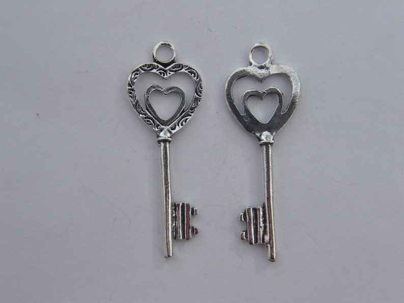BULK 20 Key pendants antique silver tone K43