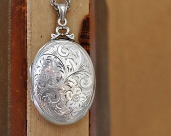 etched floral 925 sterling 2 photo frame locket Vintage find German 925 sterling silver oval locket