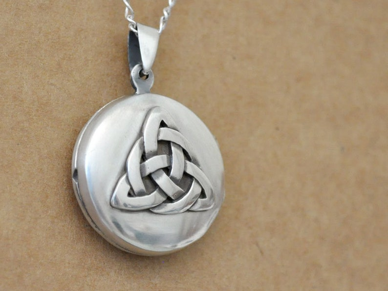 cad15b7f79a80 Sterling silver eternal knot locket necklace. vintage style.