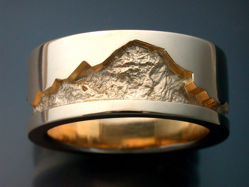 14k gold man's wedding band with rock texture image 0
