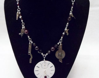 A Dangle in Time Necklace - Garnet and Silver