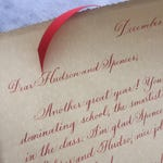 Vintage-style hand written letter from Santa in a scroll
