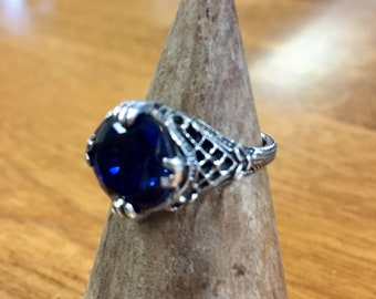Blue Sapphire Round Cut Stone in Sterling Silver Setting
