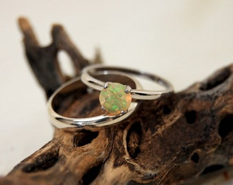 Callie - Solitaire Ring features a brilliant opal set in solid Rhodium plated sterling silver for ease of care. FREE SHIP US.