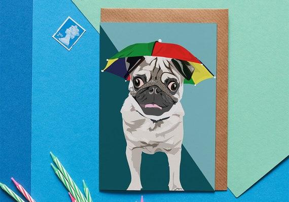 d6266a4f0f372 Arnie the pug with umbrella hat