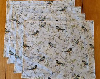 Handmade Song Bird placemats: cotton fabric with a periwinkle blue on the backside.