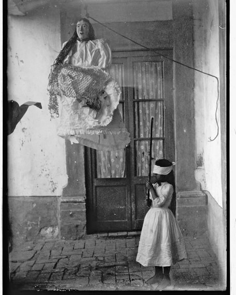 Big lady pinata about to be hit by blindfolded girl old mexico mexican victorian vintage weird unusual black white photography photo print