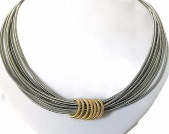 Piano wire  multi strand and gold coils  necklace