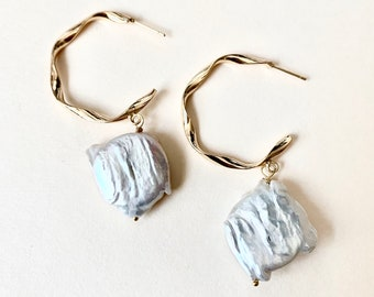 Tala Baroque White Freshwater Pearl Earrings dangling from an open hoop stud —Free Shipping to anywhere in the US