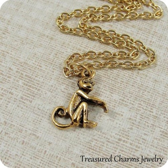 Raccoon necklace in gold plated pewter on an 18 gold plated cable chain.