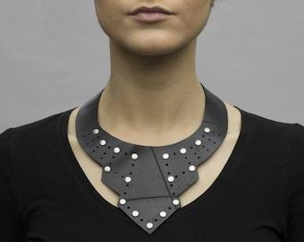 Deco-inspired collar / choker: upcycled black rubber innertube with rivet details.