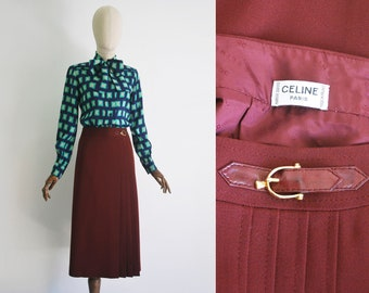 9a4b61b79 CELINE skirt. Vintage from the 1980s. Full skirt. Pleated skirt. Wool  fabric. Silk lining. Buckle at the waist. Perfect condition