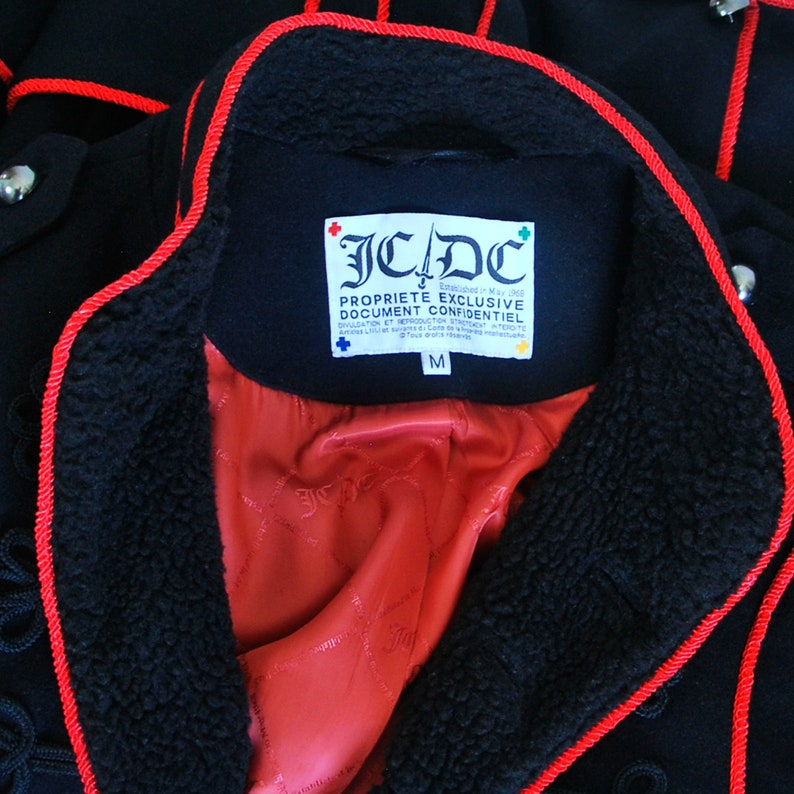 Frog closing Black color with red trim CASTELBAJAC men jacket Military style Wool and viscose. Epaulettes on the shoulders
