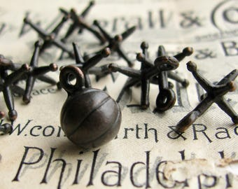 Jacks game charms and ball charm, black antiqued pewter and brass (11 charms) old fashioned toys, classic game pieces, made in USA