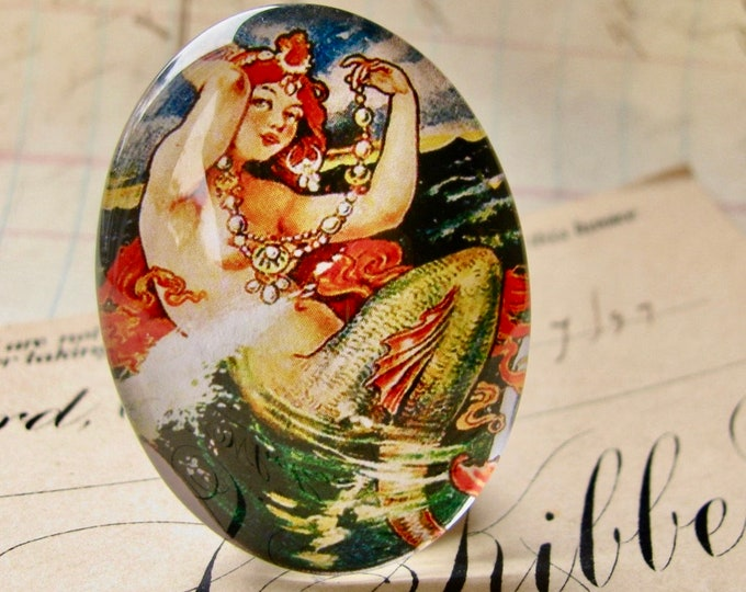 From our Magical Maidens collection, vintage mermaid illustration, red hair, 40x30mm or 25x18mm glass oval cabochon, handmade in this shop