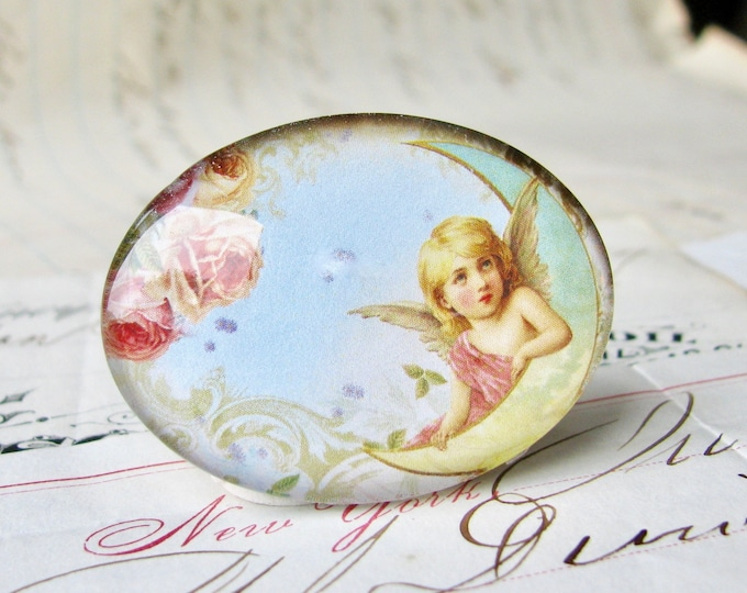 Horizontal cabochon, cherub on the moon, angel image, pink roses, blue, yellow, handmade glass cabochon, 40x30mm or 25x18mm sideways oval