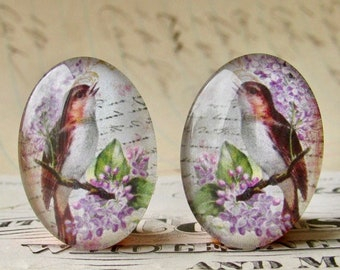 Mirrored pair of songbirds with lilacs, for earrings, opposite facing, handmade glass cabochons, 25x18mm ovals, purple flowers, left right