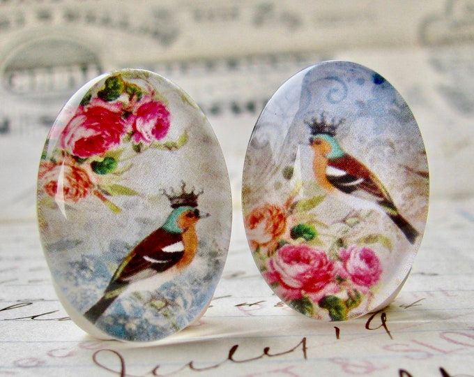 Asymmetrical pair of songbirds with crown and pink roses, for earrings, opposite facing, handmade glass cabochons, 25x18mm ovals, flowers