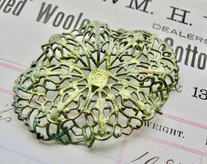 Absinthe finish - green patina with aqua highlights, rippled oval brass filigree, 35x 47mm, pierced ornament, wrap wrapping