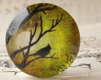 Bird silhouette in green, full moon, handmade glass oval cabochon from our Mystic Moon collection, 25mm round, bottle cap size, photo glass