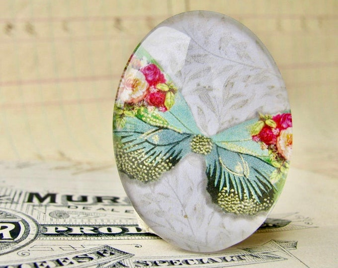 Red roses on an aqua butterfly, William Morris wallpaper background, handmade glass oval cabochon, 40x30mm, garden, rebirth, renewal