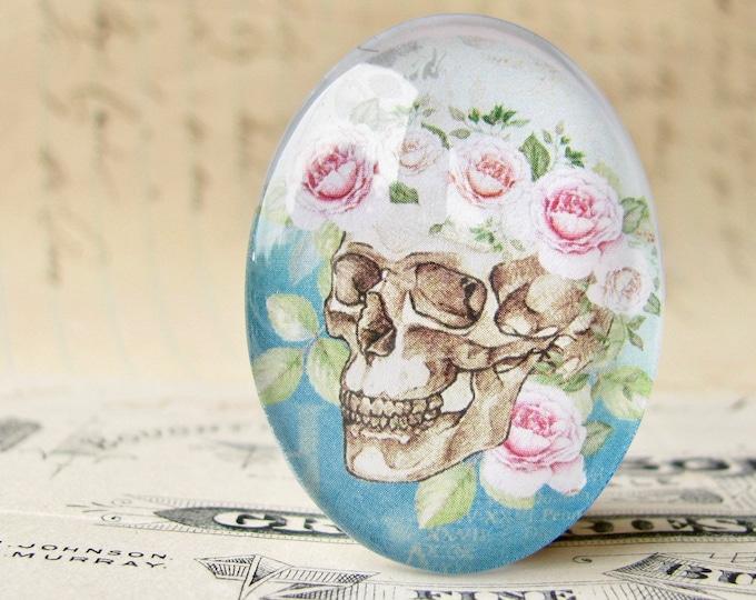 Skull with pink flower tiara on aqua, 40x30mm glass oval cabochon, Day of the Dead, Halloween, handmade, feminine macabre, bones rose tiara
