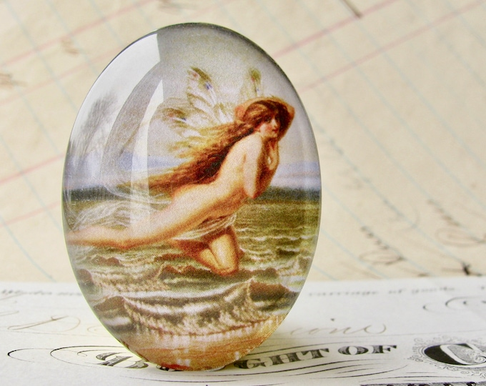 From our Magical Maidens collection, handmade 40x30mm or 25x18mm glass oval cabochon, flying nude, vintage fantasy, flying fairy