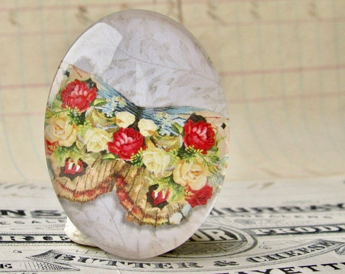 Red yellow roses on a butterfly, William Morris wallpaper background, handmade glass oval cabochon, 40x30mm, garden, rebirth, renewal