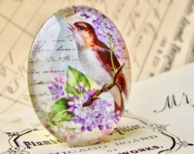 Songbird with lilacs, from our Beautiful Birds collection of handmade glass cabochons, 40x30mm or 25x18mm, purple flowers, vintage script