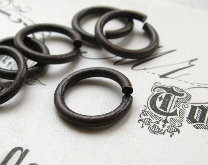 13mm jump ring, dark antiqued brass (12 rings) lead, nickel free, made in the USA, 13 gauge, aged black patina, oxidized, black jump ring