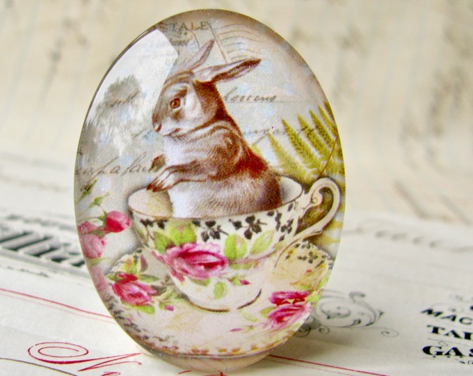 Bunny in a teacup, oval glass cabochon, 40x30mm or 25x18mm, handmade in this shop, grey rabbit, pink roses, tea party, green spring picnic