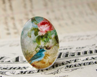 Songbird with crown, from our Beautiful Birds collection of handmade glass cabochons, 25x18mm or 40x30mm oval, pink roses