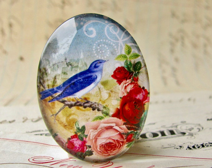 Bluebird with pink roses, from our Beautiful Birds collection of handmade glass cabochons, 40x30mm or 25x18mm oval, pink flowers